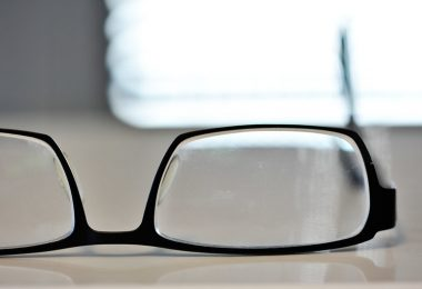 eyeglasses upside down on a table